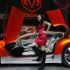 A model poses beside the Dogdge Zeo Concept car