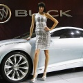 A model poses beside the world premiere display of the Buick concept car
