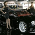 Thai models pose next to a Spyker Laviolette from the Netherlands at Thailand