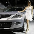 A model presents the Mazda CX-9 during a preview of the Bangkok