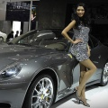 A model poses next to a Ferrari sportscar at the Beijing Auto Show