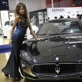 A model poses next to an Aston Martin sportscar at the Beijing Auto Show