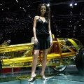 Models stand next to a Rinspeed exasis concept car at the 77th International Motor Show