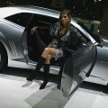 Models sits inside a Chevrolet Camaro at the 77th International Motor Show