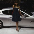 A model stands next to the Maserati Gran Turismo at the 77th International Motor Show