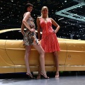 Models stand by a Stola concept car on display at the 77th International Motor Show