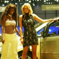 Models pose next to the New Lancia Musa at the International Motor Show