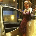 A model poses next to the Lancia Musa at the International Motor Show