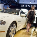 Models stand next to the Maserati Quattroporte Collezione during a press conference at the 2008 North American