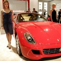 Two models stand beside the 599 GTB Fiorano Ferrari