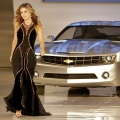 Actress Carmen Electra walks the runway with the Chevrolet Camero Concept car at the GM Style event on the eve