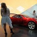 Models Fallon Jamil (L) and Krystle Wilson pose with the Mazda Kabura Concept car