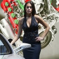 A model poses next to a Ferrari at the North American International Auto Show