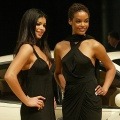 Models pose next to a Maserati at the North American International Auto Show