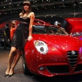 A model poses near the Alfa Romeo MiTo car on media day at the Paris Mondial