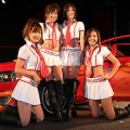 Mitsubishi Motors' racing queens pose for photographs during the 26th Tokyo Auto Salon at Makuhari Messe