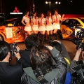 Amateur photographers takes pictures while Mitsubishi Motors' racing queens pose during the 26th Tokyo Auto Salon