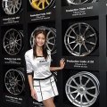 A campaign girl displays PIAA wheels during the 26th Tokyo Auto Salon