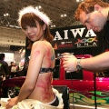 A model's back is painted by artist Daniel Power during the 26th Tokyo Auto Salon