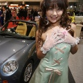 A model shows off Kumoi Motor's Copen ver.2 at the Tokyo Auto Salon