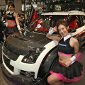 Models present Suzuki Motors' Swift Sports-X concept compact vehicle at the Tokyo Auto Salon