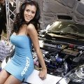 A model poses next to Toyota Celica-based custom car at the tuning maker Trust's booth of the Tokyo Auto Salon