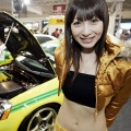A model stands next to Honda Integra Type-R-based custom car (L) at the Tokyo Auto Salon