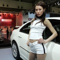 Models stand beside Honda Legend (R) and Edix (L) during the Tokyo Auto Salon