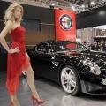 Models pose next to Italian auto maker Alfa Romeo's 'Alfa 8c Competizione'
