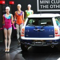 Dancers perform next to a 'Mini Cooper S Clubman' during a press preview at the 40th Tokyo Motor Show