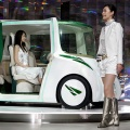 Attendants of Japan's auto giant Toyota Motor introduce the concept vehicle 'RiN'